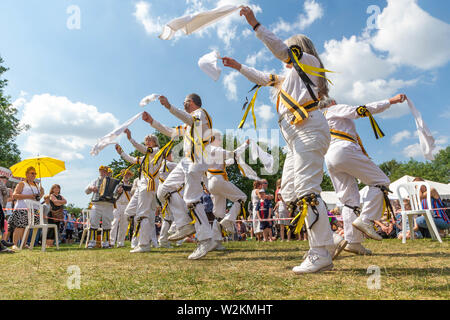 The Earl of Stamford Morris perform a dance at the 2019 Stockton Heath Festival under a hot sun - Stock Photo