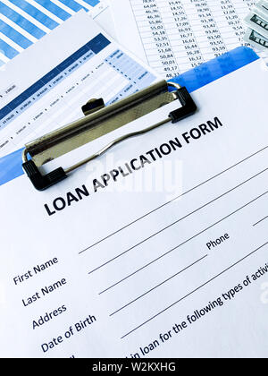 Loan application form document with graph on table - Stock Photo