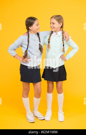 School friendship. September again. Childhood happiness. School day fun cheerful moments. Kids cute students. Schoolgirls best friends excellent pupils. Schoolgirls tidy appearance school uniform. - Stock Photo