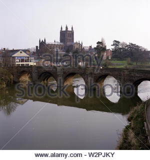 Herefords Historic  Cathedral behind old River Wye bridge with Mead and Tomkinsons Motorcycle Shop. Taken circa 1970s - Stock Photo
