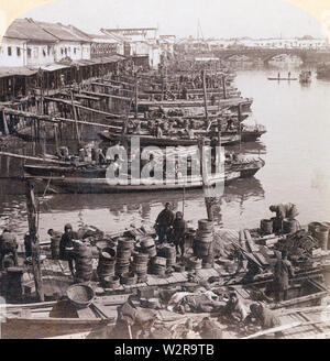 [ 1890s Japan - Tokyo Fish Market at Nihonbashi ] —   Boats are docked at the Nihonbashi fish market in Tokyo.  The market was destroyed by the Great Kanto Earthquake (Kanto Daishinsai) of September 1, 1923 (Taisho 12). It re-opened in Tsukiji in 1935 (Showa 10), where it remained until October 6, 2018 (Heisei 30).  19th century vintage stereoview. - Stock Photo