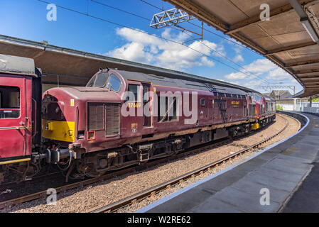Double headed Class 37 diesel locomotives of West Coast railways at Carnforth station. - Stock Photo