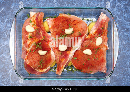 Raw meat on rib with spice ready for baking - Stock Photo