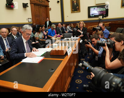 Washington, USA. 10th July, 2019. U.S. Federal Reserve Chairman Jerome Powell prepares to testify before the House Financial Services Committee on the state of the U.S. economy, on Capitol Hill in Washington, DC, the United States, on July 10, 2019. Jerome Powell said Wednesday that crosscurrents such as trade tensions and concerns about global growth have been weighing on the U.S. economic activity and outlook. Credit: Liu Jie/Xinhua/Alamy Live News - Stock Photo