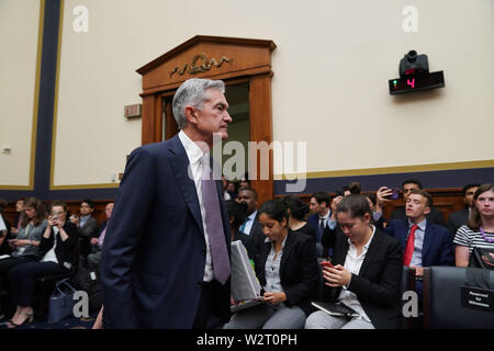 Washington, USA. 10th July, 2019. U.S. Federal Reserve Chairman Jerome Powell arrives to testify before the House Financial Services Committee on the state of the U.S. economy, on Capitol Hill in Washington, DC, the United States, on July 10, 2019. Jerome Powell said Wednesday that crosscurrents such as trade tensions and concerns about global growth have been weighing on the U.S. economic activity and outlook. Credit: Liu Jie/Xinhua/Alamy Live News - Stock Photo