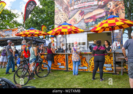 Festival visitors line up at a food booth during the annual Pig out in the Park Festival in Riverfront Park, Spokane Washington. - Stock Photo