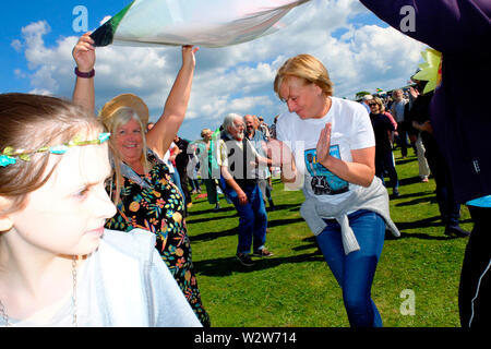 Revellers dancing at the Wolverton Folk and Blues Fair 2019 on the grounds of Wolverton Manor, Shorwell, Isle of Wight, England, UK. - Stock Photo