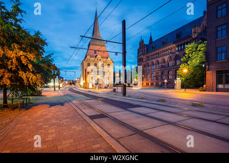 Rostock, Germany. Cityscape image of Rostock, Germany during twilight blue hour. - Stock Photo