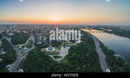 Kiev, Ukraine - June 12, 2019: Panorama of the city of Kiev, the capital of Ukraine. Panorama of Kiev in a warm summer evening at sunset with shades o - Stock Photo