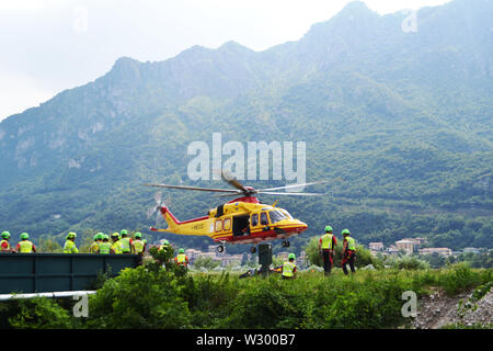 Lecco/Italy - July 10, 2019: Members of the National Alpine rescue team of Lecco are exercising in rescue with the help of helicopter service. - Stock Photo