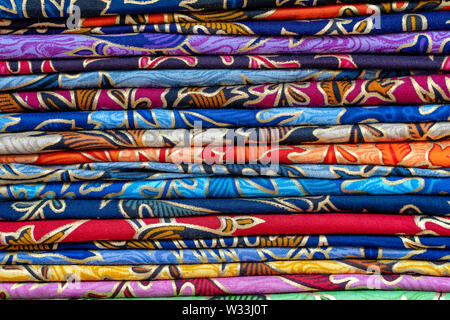Assortment of colorful sarongs for sale in local market, Island Bali, Ubud, Indonesia. Close up - Stock Photo