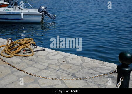 Corfu Kassiopi this photograph was taken at the small picturesqe harbour. this harbour is the focal point of this scenic village. - Stock Photo