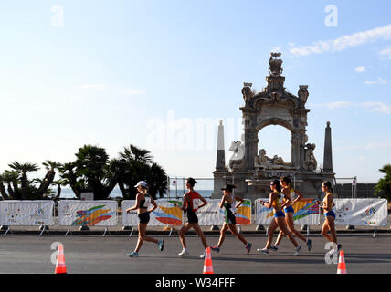Naples, Italy. 12th July, 2019. Athletes compete during the final match of Women's 20km Walk at the 30th Summer Universiade in Naples, Italy, July 12, 2019. Credit: Kong Hui/Xinhua/Alamy Live News - Stock Photo