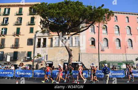 Naples, Italy. 12th July, 2019. Athletes compete during the final match of Men's 20km Walk at the 30th Summer Universiade in Naples, Italy, July 12, 2019. Credit: Kong Hui/Xinhua/Alamy Live News - Stock Photo