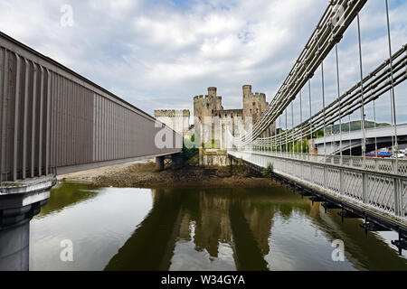 Conwy Railway Bridge adjacent to Conwy Suspension Bridge was designed by the railway engineer Robert Stephenson. It was opened in 1849. - Stock Photo