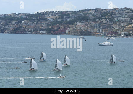 Naples, Italy. 12th July, 2019. Sailors compete during the final of RS21 Mixed Fleet Racing of Sailing at the 30th Summer Universiade in Naples, Italy, July 12, 2019. Credit: Zheng Huansong/Xinhua/Alamy Live News - Stock Photo