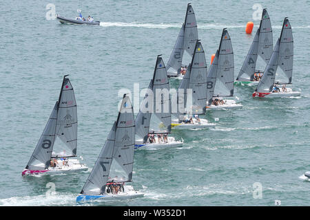 Naples, Italy. 12th July, 2019. Sailors start during the final of RS21 Mixed Fleet Racing of Sailing at the 30th Summer Universiade in Naples, Italy, July 12, 2019. Credit: Zheng Huansong/Xinhua/Alamy Live News - Stock Photo