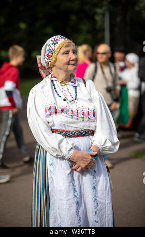 Tallinn, Estonia, 6th July, 2019: woman  in traditional estonian clothing at the  song festival grounds at the festival 'laulupidu' in traditional clo - Stock Photo
