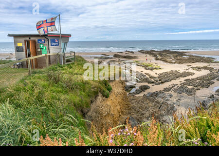 Bude Beach, North Cornwall, England. Saturday 13th July 2019. UK Weather. Lower temperatures, overcast skies and a cooling breeze on the North Cornish coast as Bude still welcomes holidaymakers to the popular coastal resort in North Cornwall. - Stock Photo