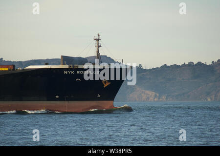 SAN FRANCISCO, CALIFORNIA, UNITED STATES - NOV 25th, 2018: Cargo Ship NYK ROMULUS entering the San Francisco Bay on its way to the Port of Oakland - a - Stock Photo
