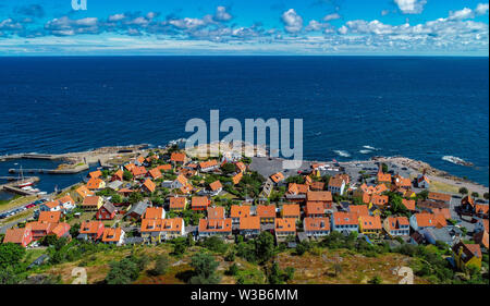 07 July 2019, Denmark, Gudhjem: City view of Gudhjem, a small town on the north coast of the Danish Baltic Sea island Bornholm (aerial view with a drone). The island Bornholm is, together with the offshore archipelago Ertholmene, Denmark's most eastern island. Thanks to its location, the island of Bornholm counts many hours of sunshine. Photo: Patrick Pleul/dpa-Zentralbild/ZB - Stock Photo