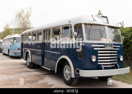 BUDAPEST, HUNGARY - April 05, 2019: Vintage oldtimer Ikarus buses on display at a classic car show. - Stock Photo