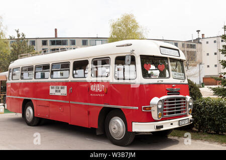 BUDAPEST, HUNGARY - April 05, 2019: A vVintage red oldtimer Ikarus bus on display at a classic car show. - Stock Photo