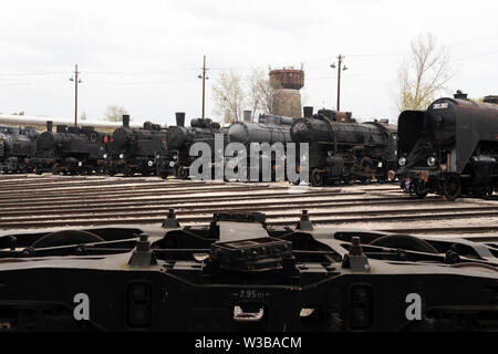 BUDAPEST, HUNGARY - April 05, 2019: Historic steam locomotives on display at the Hungarian Railway Museum. Undercarriage in foreground. - Stock Photo