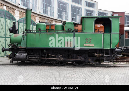 BUDAPEST, HUNGARY - April 05, 2019: A vintage small steam locomotive on display at the Hungarian Railway Museum. Side view. - Stock Photo