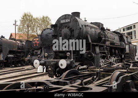 BUDAPEST, HUNGARY - April 05, 2019: Historic steam locomotive on display at the Hungarian Railway Museum. Undercarriage in foreground. - Stock Photo