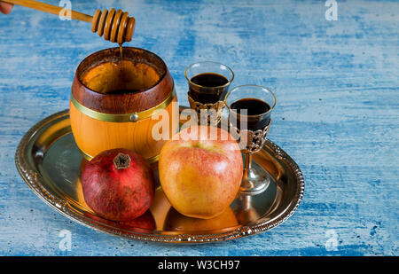 Jewish holiday honey and apples with pomegranate copy space - Stock Photo
