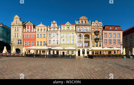 Colorful renaissance facades of old buildings on the Market square in Poznan, Poland - Stock Photo