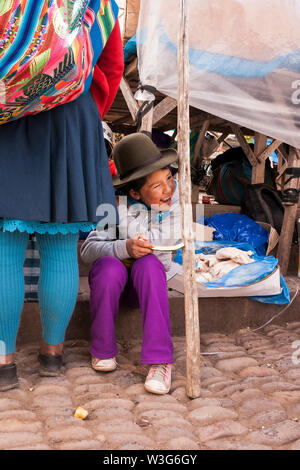 Kid winking at a street market - Stock Photo