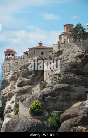 METEORA,GREECE/AUGUST 8,2018 : The Holy Monastery of Saint Nicholas of Anapafsas  and people waiting in line to visit it - Stock Photo