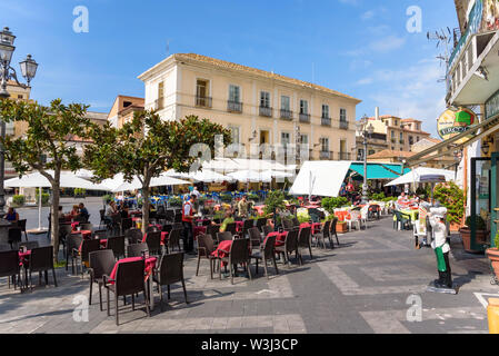 Pizzo, Calabria, Italy - September 10, 2016: Tourists visit restaurants in a picturesque town center of Pizzo in southern Italy - Stock Photo