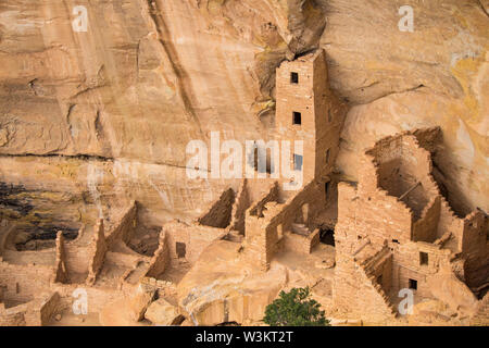 Ruins of an ancestral Puebloan cliff dwelling at Mesa Verde National Park. - Stock Photo