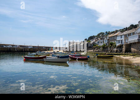 A sunny summer day at the Harbour in Mousehole, Cornwall England UK - Stock Photo