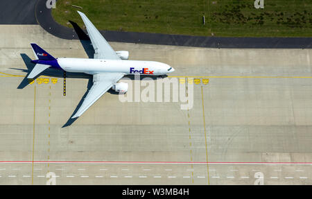 Aerial photo of the airport Cologne/Bonn 'Konrad Adenauer' with FedEx freight aircraft on the apron, international commercial airport in the southeast - Stock Photo