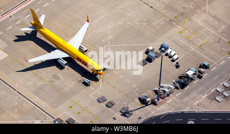 , Aerial photograph of the airport Cologne/Bonn 'Konrad Adenauer' with DHL freight aircraft on the apron, international commercial airport in the sout - Stock Photo