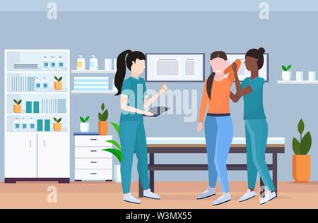 therapist examining injured patient african american nurse masseuse doing healing treatment manual sport physical therapy rehabilitation concept - Stock Photo
