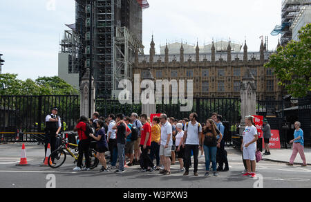 Westminster, London, UK. 17th July, 2019. Security is tight in Westminster as the  Prime Minister arrives ahead of Prime Minister's Questions in Parliament today.  Remain protesters stand outside Parliament with their EU flags. Credit: Maureen McLean/Alamy Live News - Stock Photo