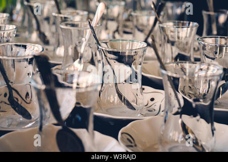 Turkish tea glass background with metal spoon - Stock Photo