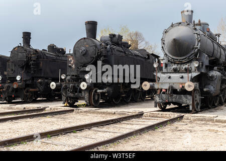 BUDAPEST, HUNGARY - April 05, 2019: Historic steam locomotives on display at the Hungarian Railway Museum. Front view. - Stock Photo