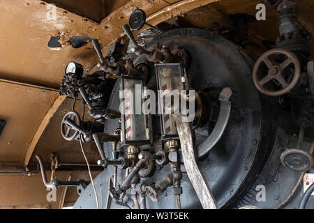 BUDAPEST, HUNGARY - April 05, 2019: Firebox and valves of a historic steam locomotive at the Hungarian Railway Museum. - Stock Photo
