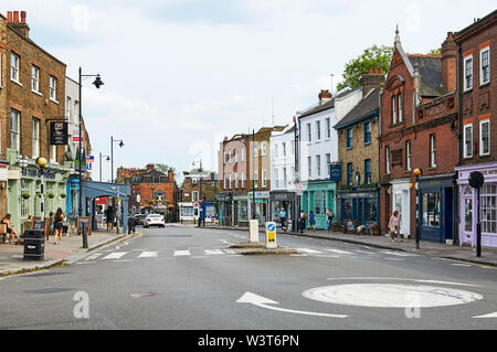 The centre of Highgate village in North London UK, looking south down Highgate High Street from the roundabout - Stock Photo