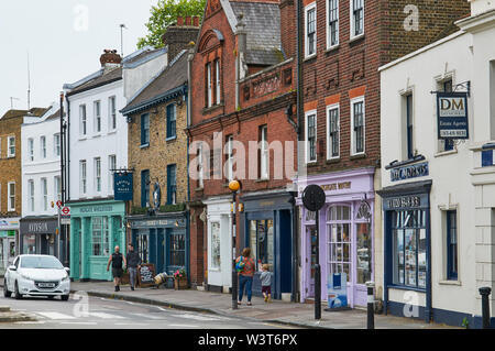 Shops and Georgian buildings along Highgate High Street, in Highgate Village, North London UK, with pedestrians - Stock Photo