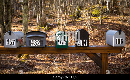 Numbered mailboxes, in a rural area near Bakersville, North Carolina, USA. - Stock Photo