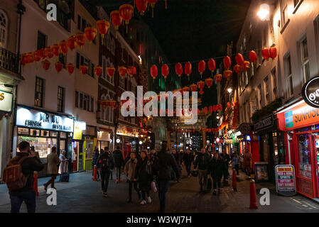 LONDON, ENGLAND, DECEMBER 10th, 2018: People walking in China Town, decorated by Chinese lanterns during christmas and new year in London, UK. - Stock Photo