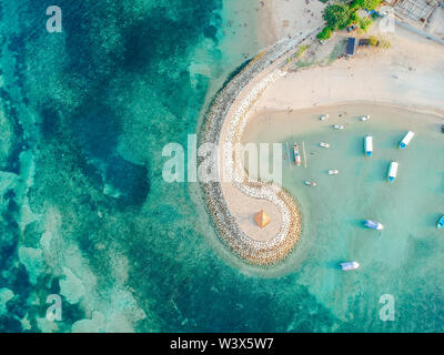 Aerial drone view of ocean, boats, beach, shore In Sanur Beach, Bali, Indonesia with with Traditional Balinese Fishing Boats amazing blue ocean. - Stock Photo