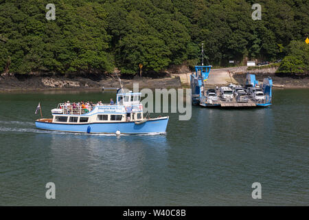 The King Harry vehicular chain ferry, and an Enterprise Boat trips passenger boat, on the Fal River EstuaryCornwall, England. - Stock Photo